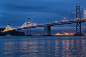 photo showing the bay bridge at night