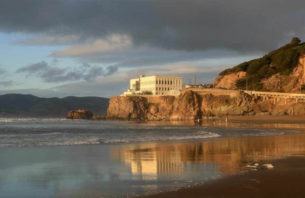 photo shows the cliff house sitting on a large rocky cliff, overlooking the ocean