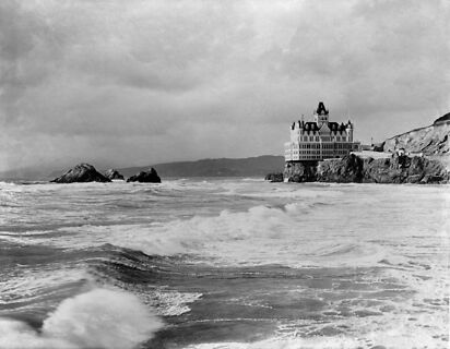 photo is black and white, and an old picture of what the cliff house used to look like. it was much more like a castle back in the day