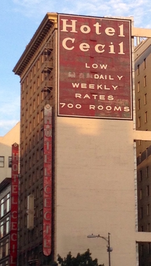 photo shows the side of the cecil hotel with its rates and weekly prices painted on